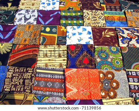 Colorful fabrics sold at the street market in Maputo, Mozambique - stock photo