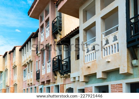 Colorful facades of houses in mediterranean style - stock photo