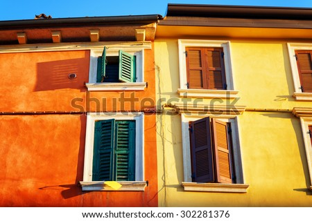 Colorful facades of old houses in Verona (Italy) in morning sun. Verona is a popular tourist destination of Europe.