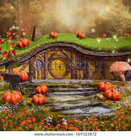 Colorful fairytale cottage with pumpkins, mushrooms and flowers - stock photo