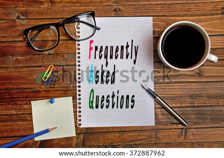 Colorful FAQ words on paper  - stock photo
