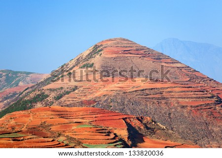Colorful farmland in dongchuan of china. - stock photo