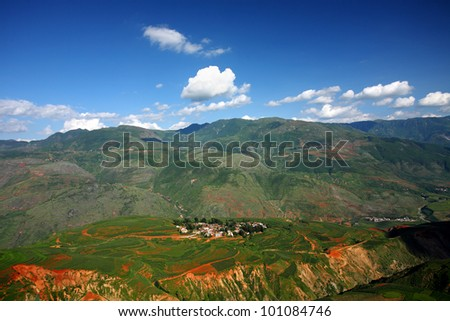 Colorful farmland with village,dongchuan,china - stock photo
