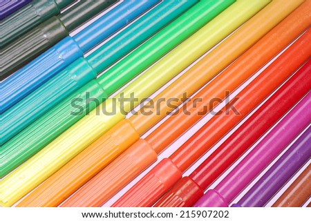 Colorful felt pens as striped texture background.