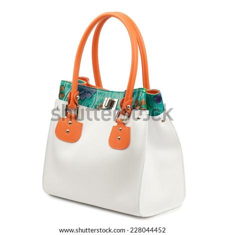 Colorful female handbag isolated on white background.  - stock photo