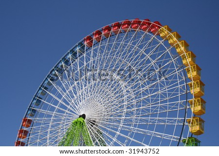 Colorful Ferris Wheel against blue sky