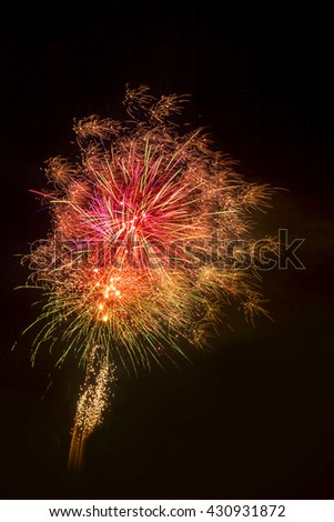 colorful fireworks in a dark night sky - stock photo