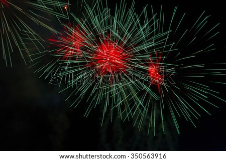 colorful fireworks in dark sky with smoke, copyspace on the left