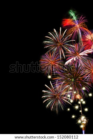 Colorful Fireworks on a black background with copy space on the left side of the image. - stock photo