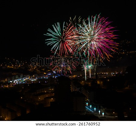 Colorful fireworks over a night sky village, Sao Jose festival in Povoa de Lanhoso.  - stock photo