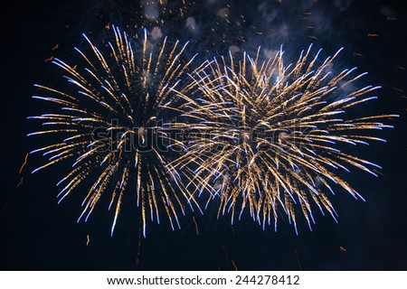 Colorful fireworks over dark sky, displayed during a celebration - stock photo