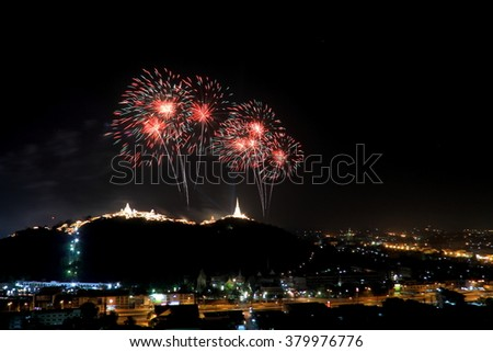Colorful fireworks over the city (Annual Fair at Phra Nakhon Kiri, Phetchaburi, Thailand) - stock photo