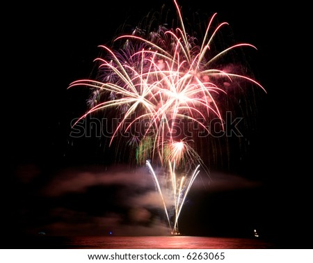 Colorful Fireworks over water - stock photo