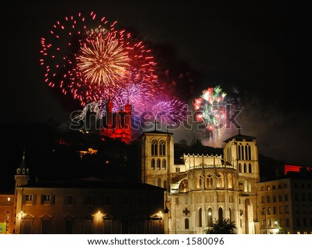 Colorful fireworks sparkle over the basilica (Fourviere) and the cathedral (St Jean) in the city of Lyon (France) - stock photo