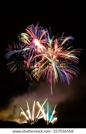 Colorful fireworks with copy space on top - insert your own text - stock photo