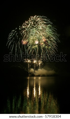 Colorful fireworks with water reflection