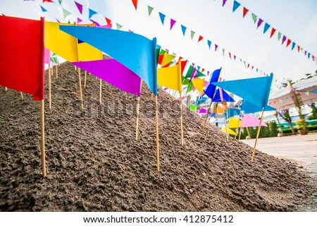 Colorful flags on the sand in Songkran festival at Thailand. - stock photo