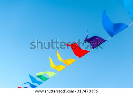 colorful flags under the blue sky - stock photo