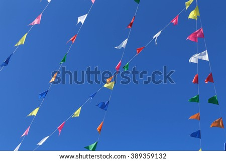 colorful flags with blue sky