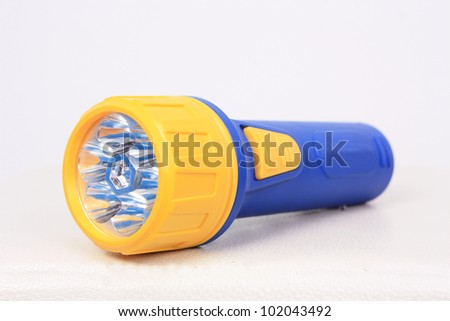 Colorful flashlight in white background - stock photo