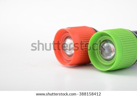 Colorful flashlights on a white background - stock photo