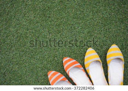 colorful flat shoes with grass background