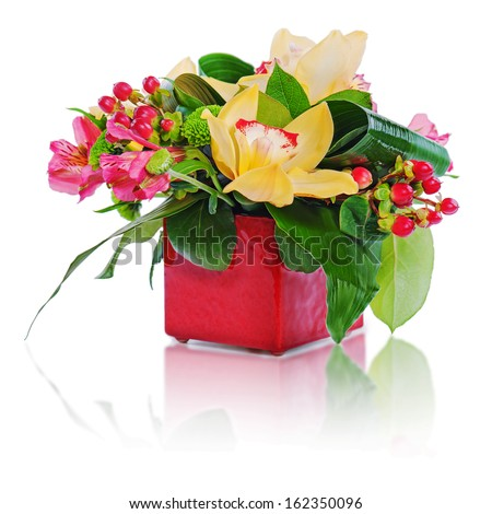 colorful floral bouquet of roses and orchids arrangement centerpiece in vase isolated on white background - stock photo