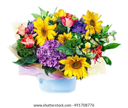Colorful floral bouquet of roses, lilies, sunflowers and irises arrangement centerpiece in vase isolated on white background.