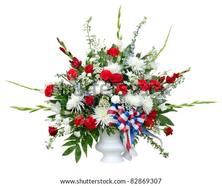 Colorful flower arrangement in urn isolated on white - stock photo
