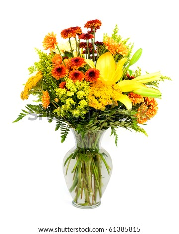 Colorful flower arrangement with fall colors isolated on white. - stock photo