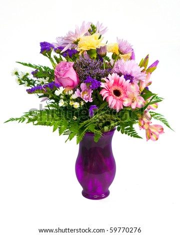 Colorful flower bouquet arrangement in vase isolated on white. - stock photo