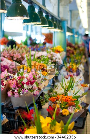 Colorful flower bouquets for sale at the Pike Place Market, Seattle. Short depth of field. - stock photo