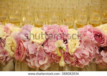 Colorful flower decoration on wedding table - stock photo