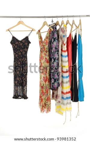 Colorful flowered patterned dress in a wooden hanger