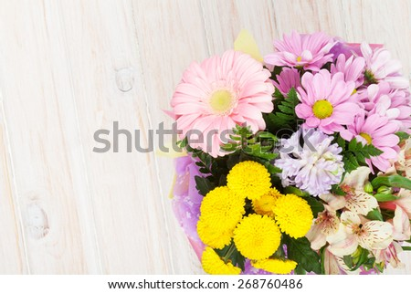 Colorful flowers bouquet on white wooden table. Top view with copy space - stock photo