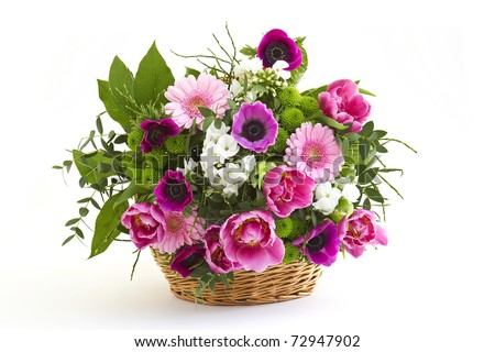 colorful flowers in a basket - stock photo