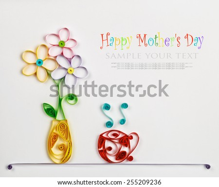 colorful flowers in a vase and a hot cup made of quilling. The text is an example and can be easily removed - stock photo