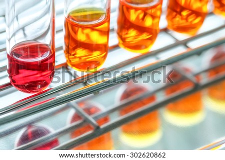 Colorful fluid in test tube for laboratory use - stock photo