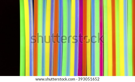 Colorful fluorescent light neon on black background - stock photo