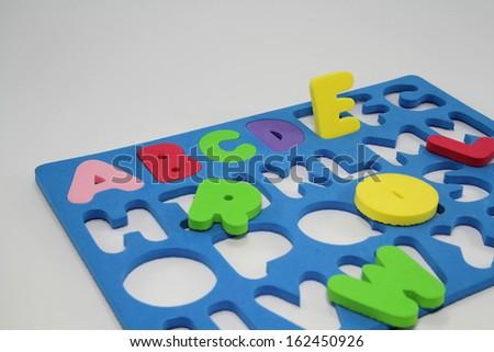 Colorful Foam Alphabet Puzzle.Educational foam alphabet puzzle isolated on white background. - stock photo
