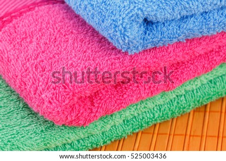 Colorful folded towels closeup picture.