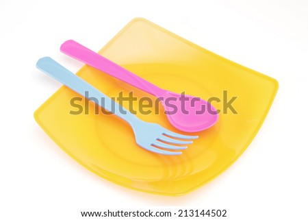 Colorful fork and spoon on isolated white background