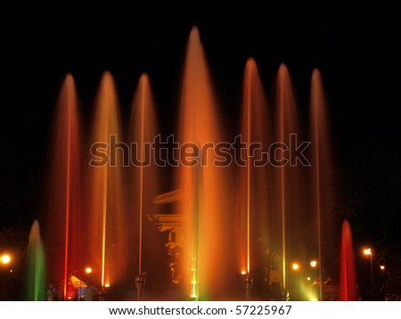 Colorful fountain in night city park . - stock photo