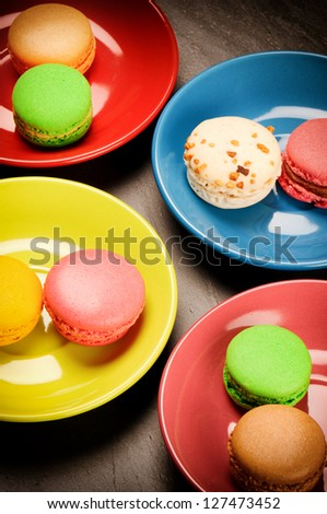 Colorful French macaroons on stone background - stock photo