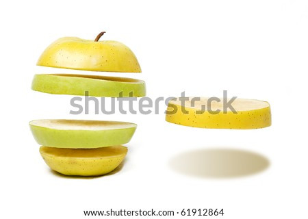 Colorful fresh apples forgot about gravity - stock photo