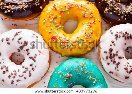 colorful fresh donuts on a white background - stock photo