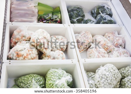 colorful frozen vegetables in a supermarket in the refrigerator - stock photo