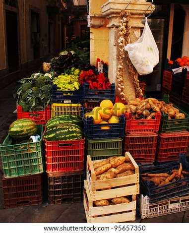 Colorful fruit and vegetables in crates on the street corner in Corfu, Greece. - stock photo