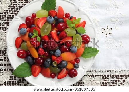 Colorful fruit salad on a  plate. Healthy food. - stock photo