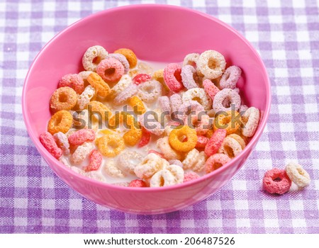 Colorful funny breakfast cereals - stock photo